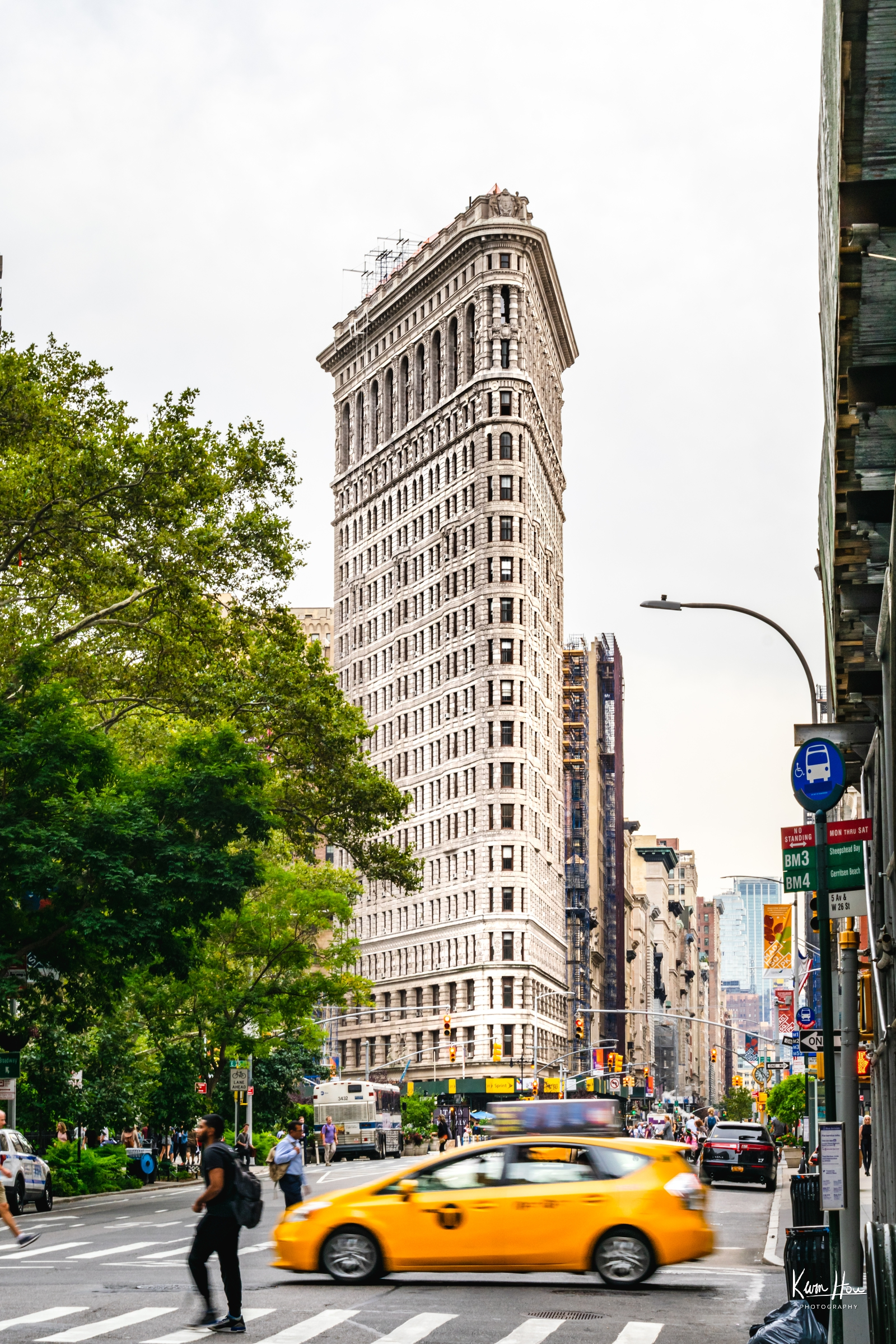 Flat Iron Building With Taxi Motion Blur